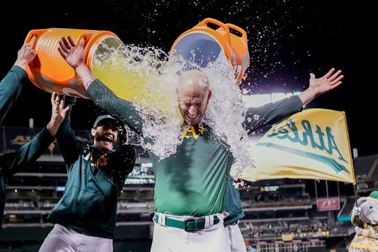 Mike Fiers gets doused after his no-hitter on Tuesday.