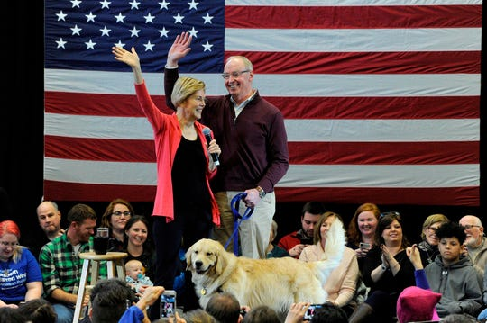 In this file photo taken on January 12, 2019 Senator Elizabeth Warren (D-MA), husband Bruce Mann and their dog Bailey take the stage before Warren addresses an Organizing Event as part of her exploratory presidential committee at Manchester Community College in Manchester, NH on Saturday.
