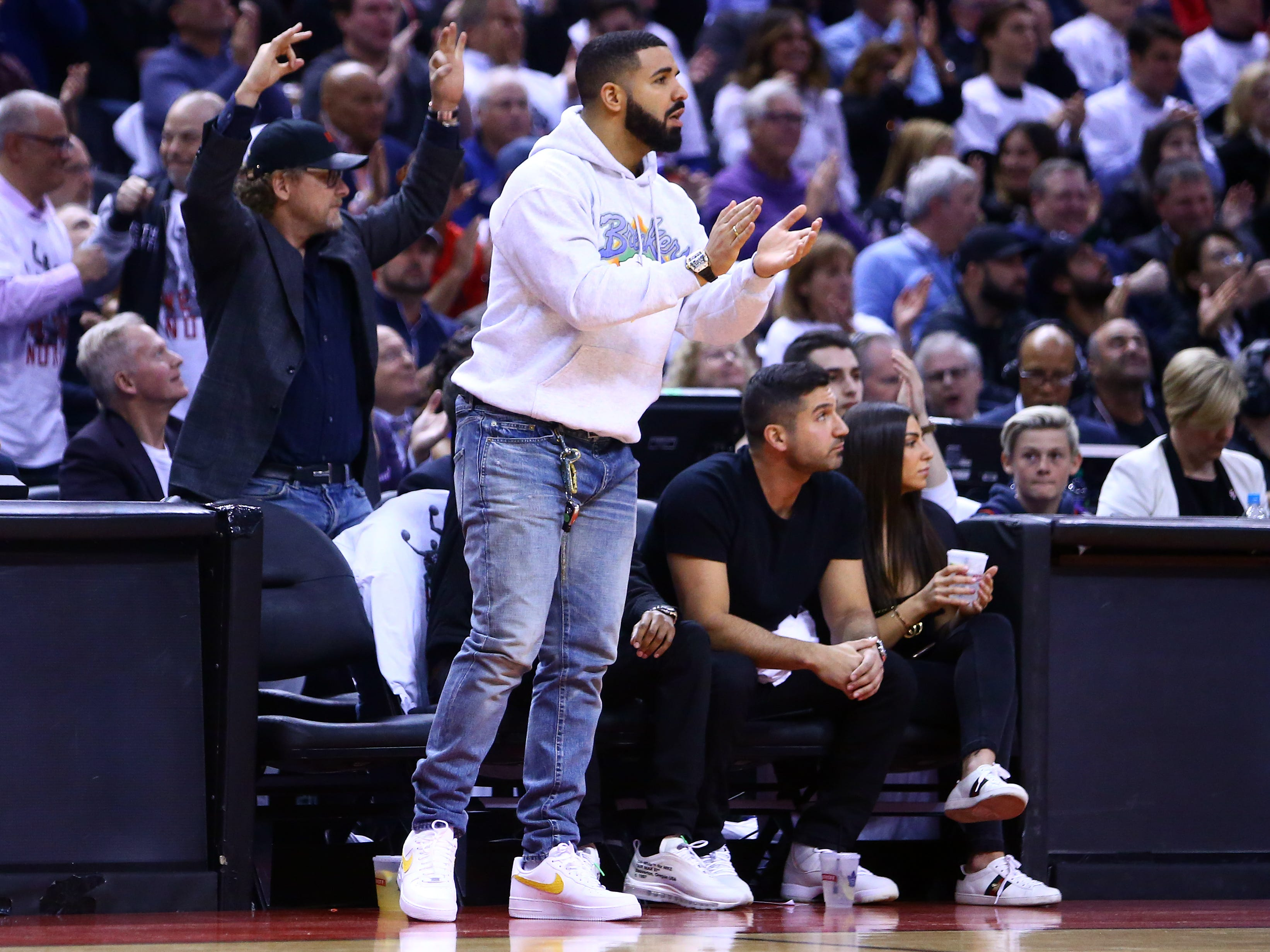 May 7: Singer Drake cheers for his Raptors during Game 5 in Toronto. The Raptors routed the 76ers 125-89.