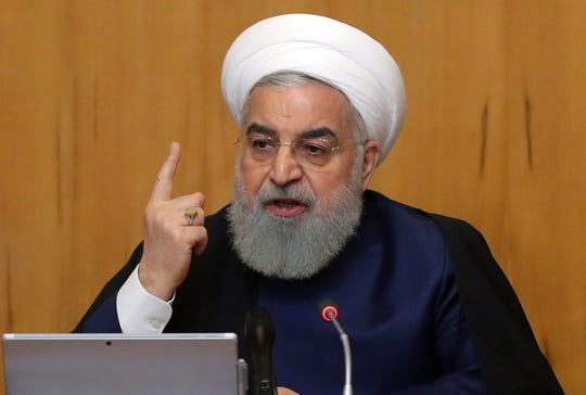 President Hassan Rouhani says Iran will no longer comply with parts of an international  nuclear agreement.