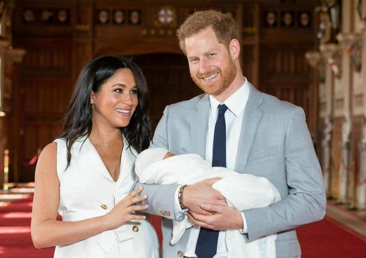 """Britain's Prince Harry and Meghan, Duchess of Sussex, during a photocall with their newborn son, in St George's Hall at Windsor Castle, Windsor, south England, Wednesday May 8, 2019. Baby Sussex was born Monday at 5:26 a.m. (0426 GMT; 12:26 a.m. EDT) at an as-yet-undisclosed location. An overjoyed Harry said he and Meghan are """"thinking"""" about names. (Dominic Lipinski/Pool via AP) ORG XMIT: LON211"""