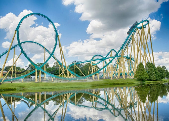 Krakenat SeaWorld Orlando soars 149 feet tall, cranks up to 65 mph and unleashes one inversion after another, including a dive loop and a cobra roll.