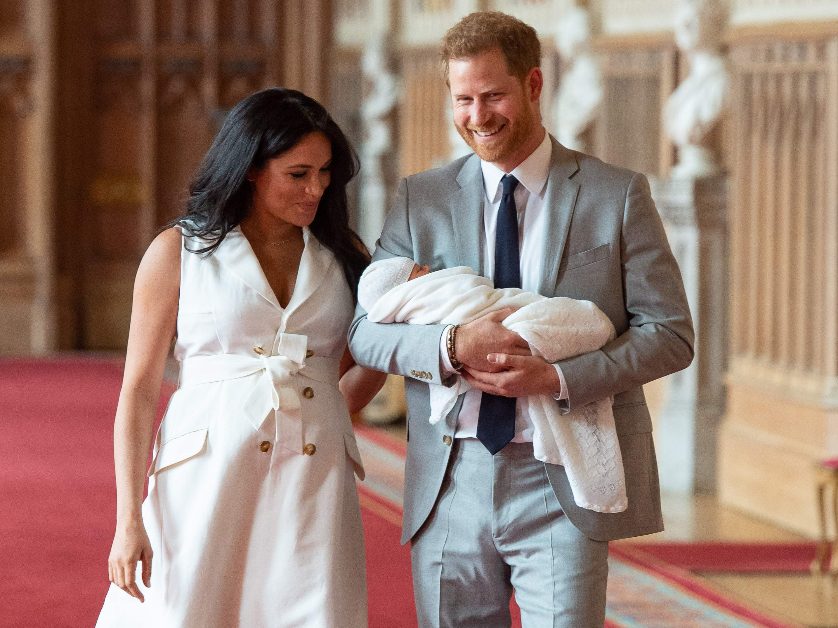 Britain's Prince Harry, Duke of Sussex (R), and his wife Meghan, Duchess of Sussex, pose for a photo with their newborn baby son in St George's Hall at Windsor Castle in Windsor, west of London on May 8, 2019. (Photo by Dominic Lipinski / POOL / AFP)DOMINIC LIPINSKI/AFP/Getty Images ORIG FILE ID: AFP_1GA08B