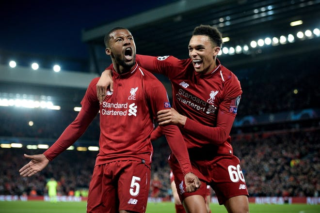 Liverpool's Georginio Wijnaldum (L) celebrates with his teammate Trent Alexander-Arnold (R) after scoring the 3-0 goal during the UEFA Champions League semi final second leg soccer match between Liverpool FC and FC Barcelona at Anfield stadium in Liverpool, Britain, 07 May 2019.  EPA-EFE/PETER POWELL