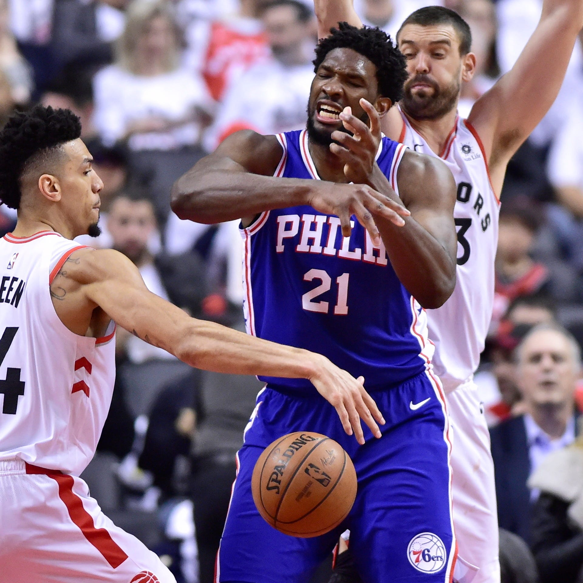 Philadelphia 76ers center Joel Embiid (21) loses the ball as Toronto Raptors guard Danny Green (14) gains control of it during the second half.