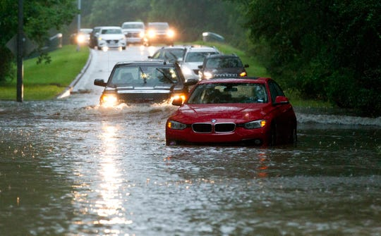 Vehicles wade through flooded Kingwood Drive as thunderstorms hit the Kingwood area Tuesday, May 7, 2019, in Texas.