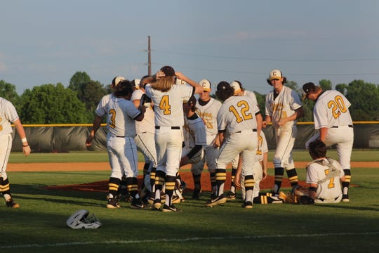 Crescent baseball team celebrates their 10-3 win.