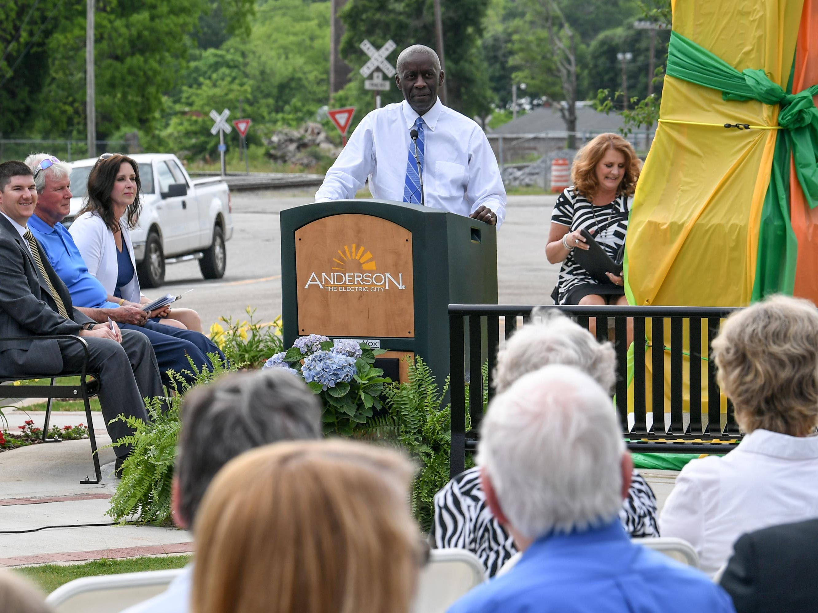 Mayor Terence Roberts speaks before unveiling the Under the bridge project called Textile Point in downtown Anderson Thursday, May 9, 2019. Scott Foster of Anderson designed the monument honoring years of textile mills in Anderson, with support partners from To Benefit Anderson, South Carolina Heritage Corridor, the Rotary Club of Anderson, and the City of Anderson.