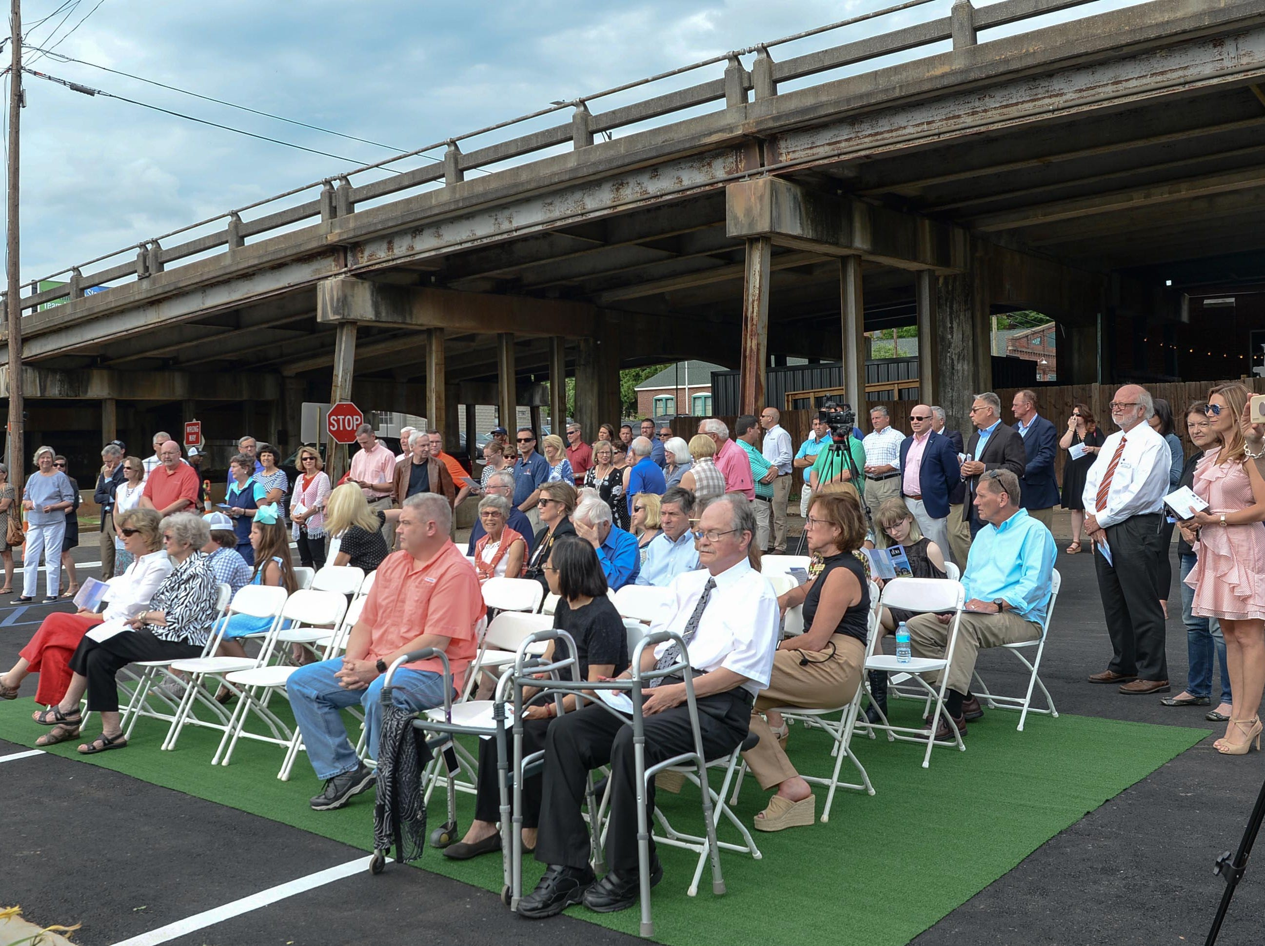 A crowd listens to Mayor Terence Roberts speak about the Under the bridge project called Textile Point in downtown Anderson Thursday, May 9, 2019. Scott Foster of Anderson designed the monument honoring years of textile mills in Anderson, with support partners from To Benefit Anderson, South Carolina Heritage Corridor, the Rotary Club of Anderson, and the City of Anderson.