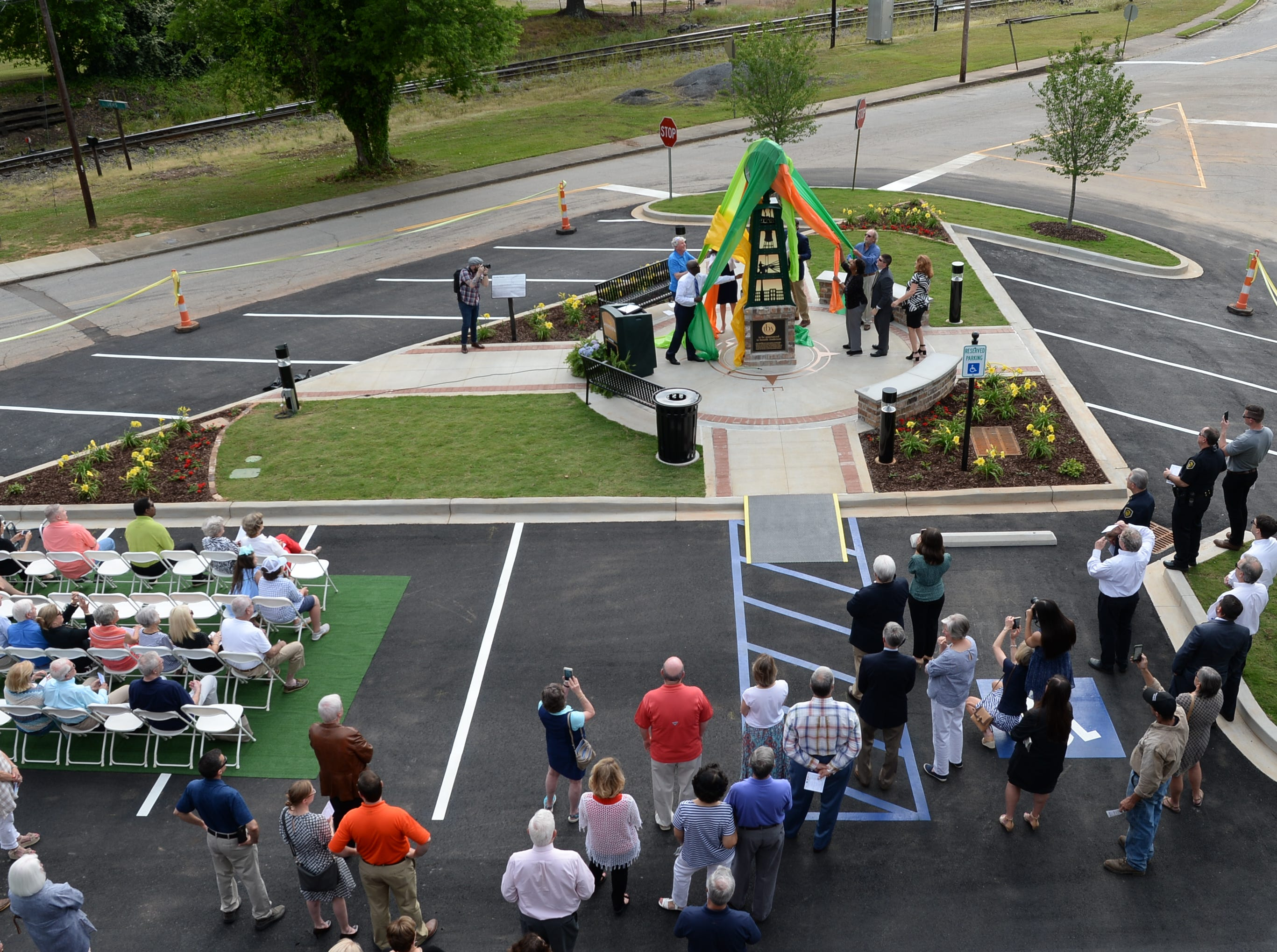 Anderson officials help unveil the Under the bridge project called Textile Point in downtown Anderson Thursday, May 9, 2019. Scott Foster of Anderson designed the monument honoring years of textile mills in Anderson, with support partners from To Benefit Anderson, South Carolina Heritage Corridor, the Rotary Club of Anderson, and the City of Anderson.