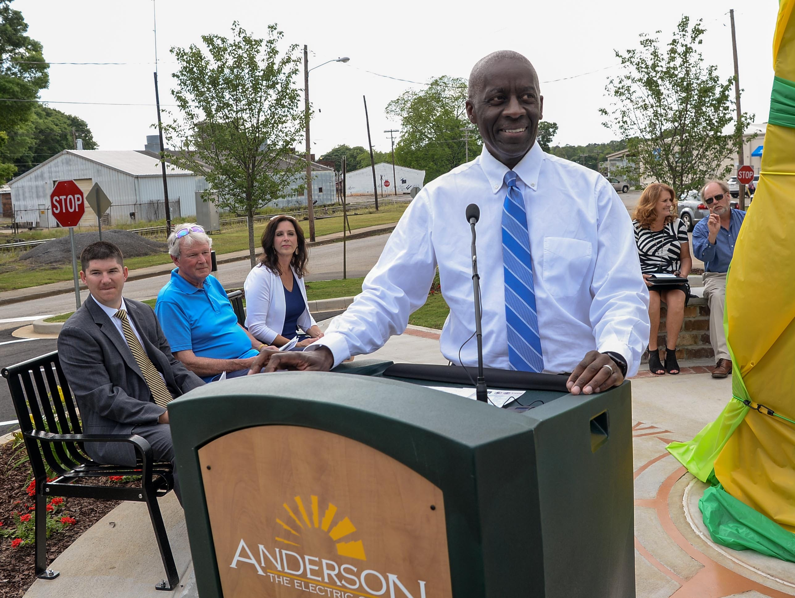 Mayor Terence Roberts gets ready to start the program to unveil the Under the bridge project called Textile Point in downtown Anderson Thursday, May 9, 2019. Scott Foster of Anderson designed the monument honoring years of textile mills in Anderson, with support partners from To Benefit Anderson, South Carolina Heritage Corridor, the Rotary Club of Anderson, and the City of Anderson.