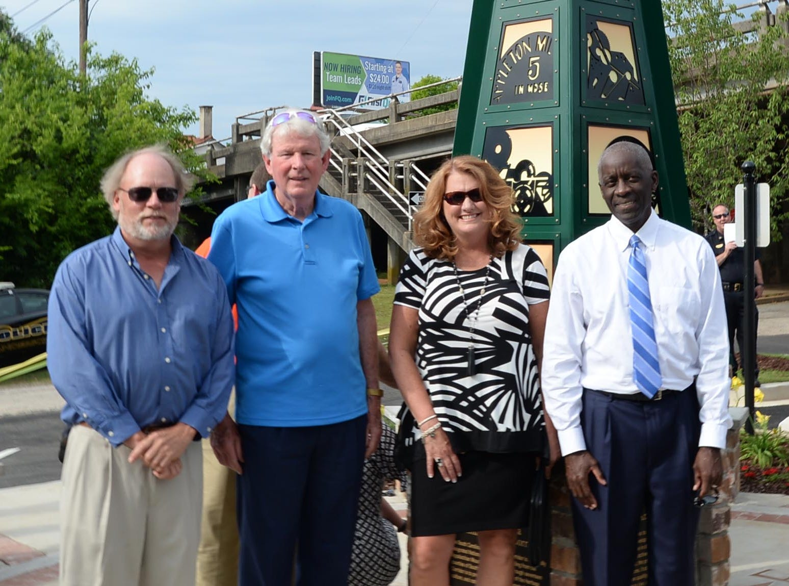 Designer Scott Foster, left, John Miller, Jr., Kimberly Spears , Anderson Economic Director, and Mayor Terence Roberts after helping unveil the Textile Point monument in downtown Anderson Thursday, May 9, 2019. Scott Foster of Anderson designed the monument honoring years of textile mills in Anderson, with support partners from To Benefit Anderson, South Carolina Heritage Corridor, the Rotary Club of Anderson, and the City of Anderson.