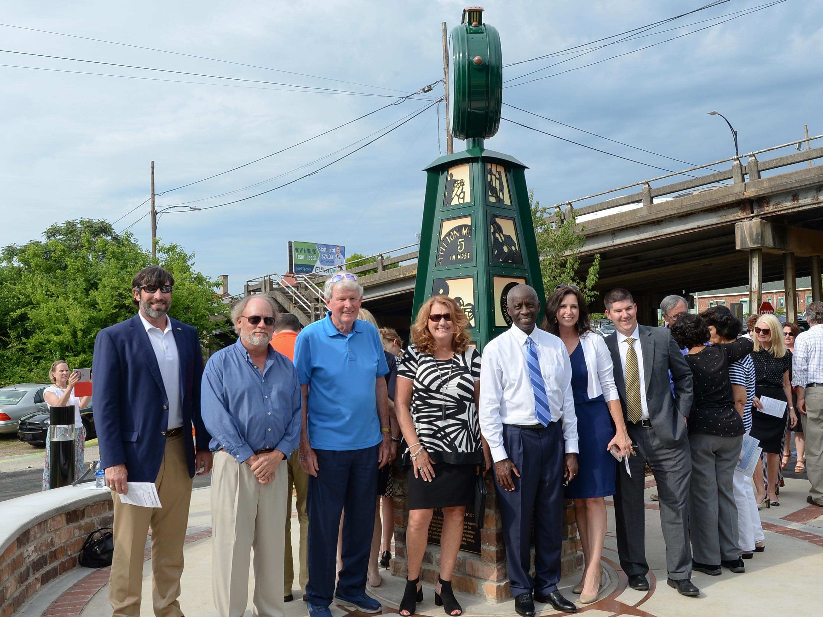 City Councilman John Roberts, left, Designer Scott Foster, John Miller, Jr., Kimberly Spears, Anderson Economic Director, and Mayor Terence Roberts, Michelle McCollum, President and CEO of SC Heritage Corridor, and City Manager David McCuen, stand for a photo after helping unveil the Textile Point monument after unveiling it in downtown Anderson Thursday, May 9, 2019. Scott Foster of Anderson designed the monument honoring years of textile mills in Anderson, with support partners from To Benefit Anderson, South Carolina Heritage Corridor, the Rotary Club of Anderson, and the City of Anderson.