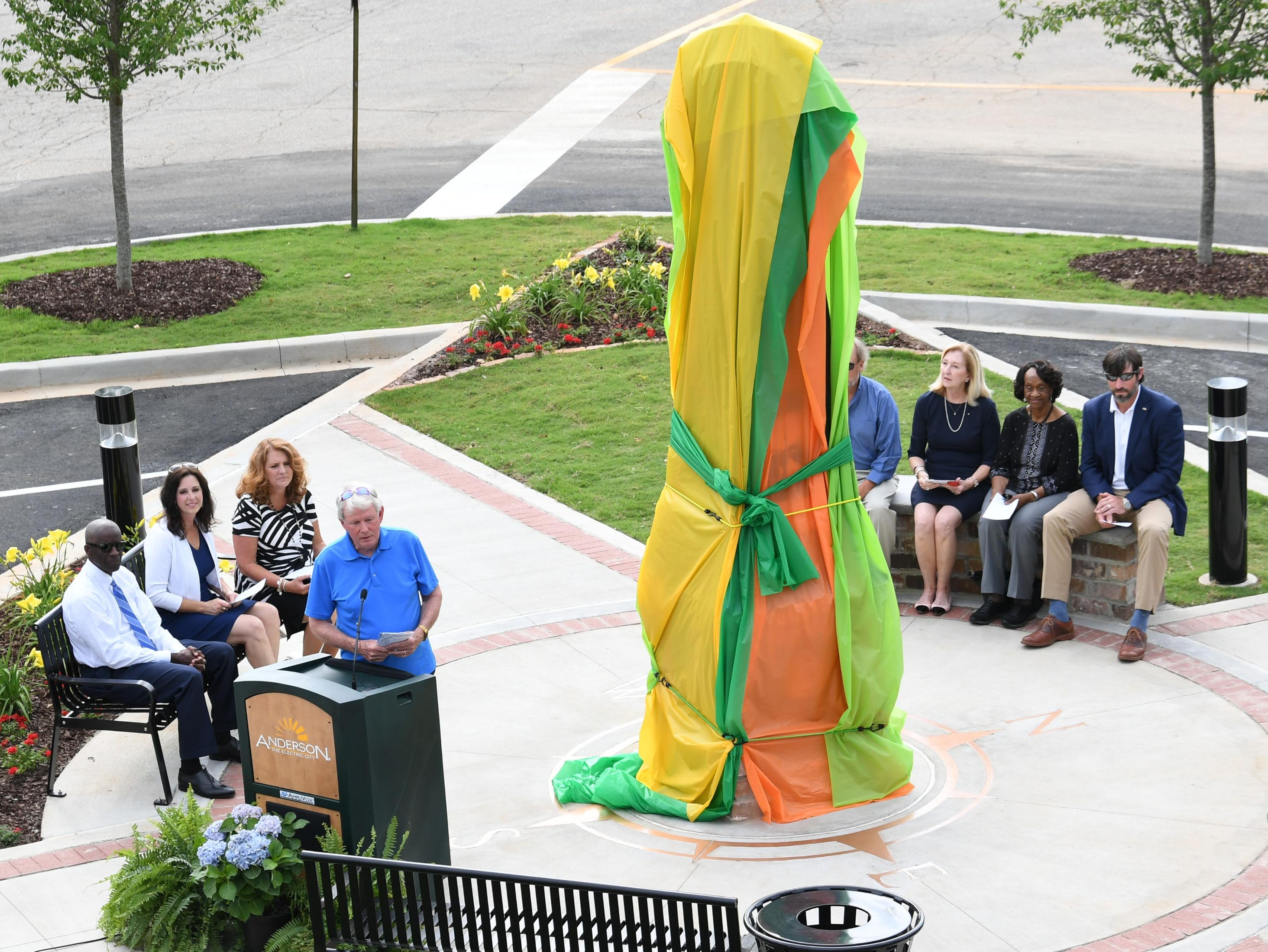 John Miller, Jr. speaks before helping unveil the Under the bridge project called Textile Point in downtown Anderson Thursday, May 9, 2019. Scott Foster of Anderson designed the monument honoring years of textile mills in Anderson, with support partners from To Benefit Anderson, South Carolina Heritage Corridor, the Rotary Club of Anderson, and the City of Anderson.