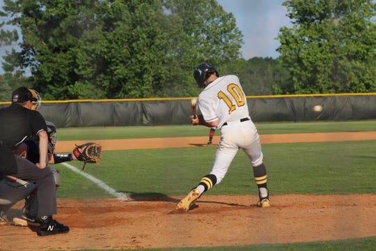 Jarrett Oakes tries to make contact on a pitch.