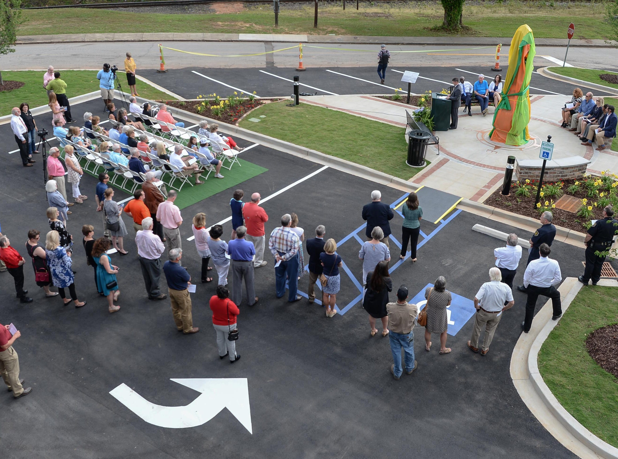 David McCuen, city manager, speaks before helping unveil the Under the bridge project called Textile Point in downtown Anderson Thursday, May 9, 2019. Scott Foster of Anderson designed the monument honoring years of textile mills in Anderson, with support partners from To Benefit Anderson, South Carolina Heritage Corridor, the Rotary Club of Anderson, and the City of Anderson.