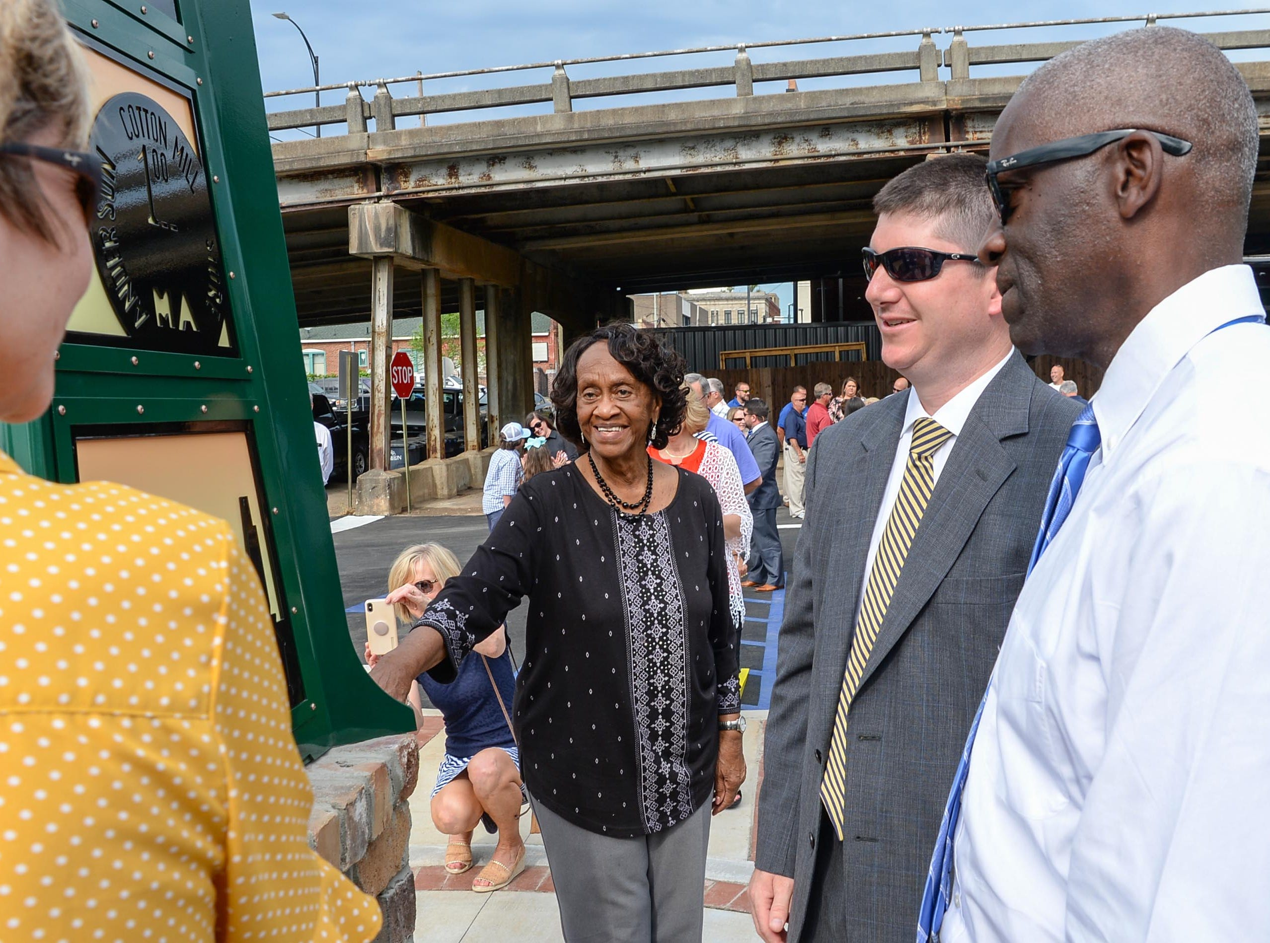 Beth Batson, left, Bea Thompson, David McCuen, and Mayor Terence Roberts, right, look closely at the Textile Point monument after unveiling it in downtown Anderson Thursday, May 9, 2019. Scott Foster of Anderson designed the monument honoring years of textile mills in Anderson, with support partners from To Benefit Anderson, South Carolina Heritage Corridor, the Rotary Club of Anderson, and the City of Anderson.