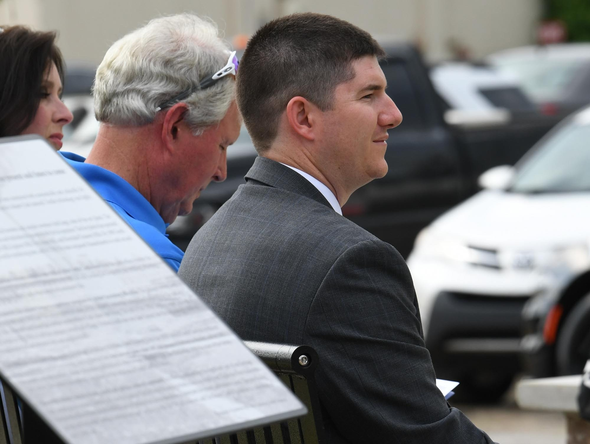 City Manager David McCuen listens to Mayor Terence Roberts speak before unveiling the Under the bridge project called Textile Point in downtown Anderson Thursday, May 9, 2019. Scott Foster of Anderson designed the monument honoring years of textile mills in Anderson, with support partners from To Benefit Anderson, South Carolina Heritage Corridor, the Rotary Club of Anderson, and the City of Anderson.