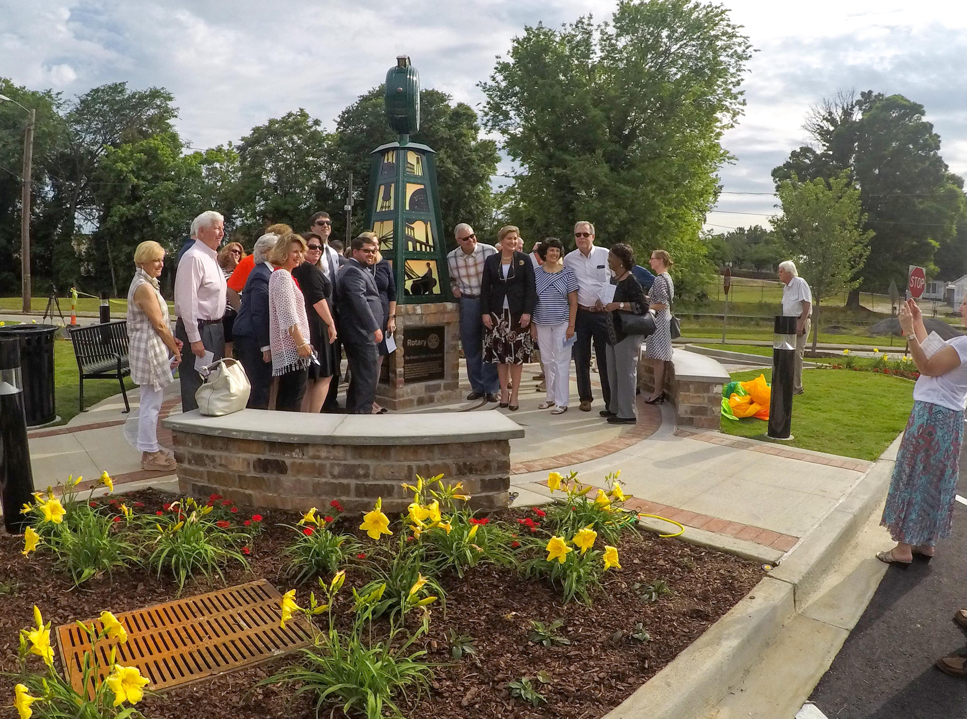 The Rotary Club of Anderson pose for a photo after watching Anderson officials unveil the Under the bridge project called Textile Point in downtown Anderson Thursday, May 9, 2019. Scott Foster of Anderson designed the monument honoring years of textile mills in Anderson, with support partners from To Benefit Anderson, South Carolina Heritage Corridor, the Rotary Club of Anderson, and the City of Anderson.