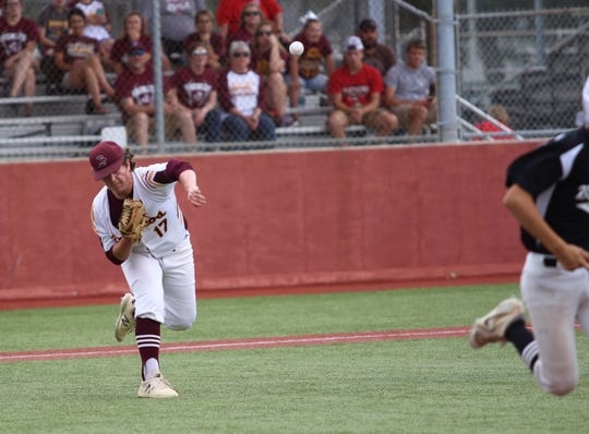 Simpson pitcher Landon Meyers throws out a Harrisonburg runner at first Wednesday afternoon at McMurry Park.