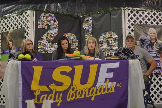 Montgomery softball seniors Carlee (second left) and Jaycee (second right) Carter sign with LSU of Eunice Thursday.