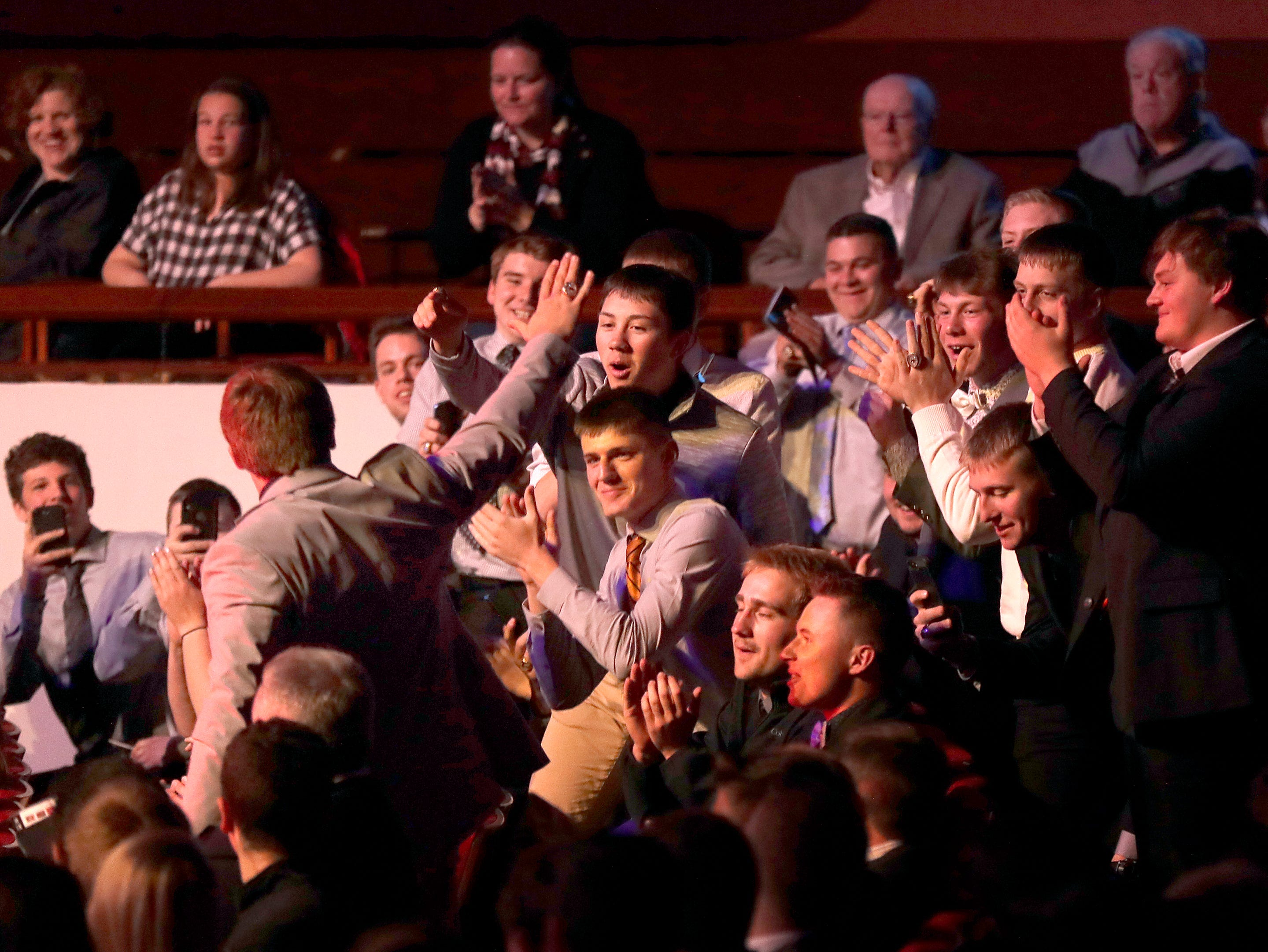 Football Player of the Year, Iola-Scandinavia's Bryce Huettner his team mates react to the award announcement during the Wisconsin High School Sports Awards show at the Fox Cities Performing Arts Center on Wednesday, May 8, 2019, in Appleton, Wis. Olympic champion Michael Phelps was the guest speaker. The annual event was presented by USA TODAY NETWORK-Wisconsin.  Wm. Glasheen/USA TODAY NETWORK-Wisconsin.