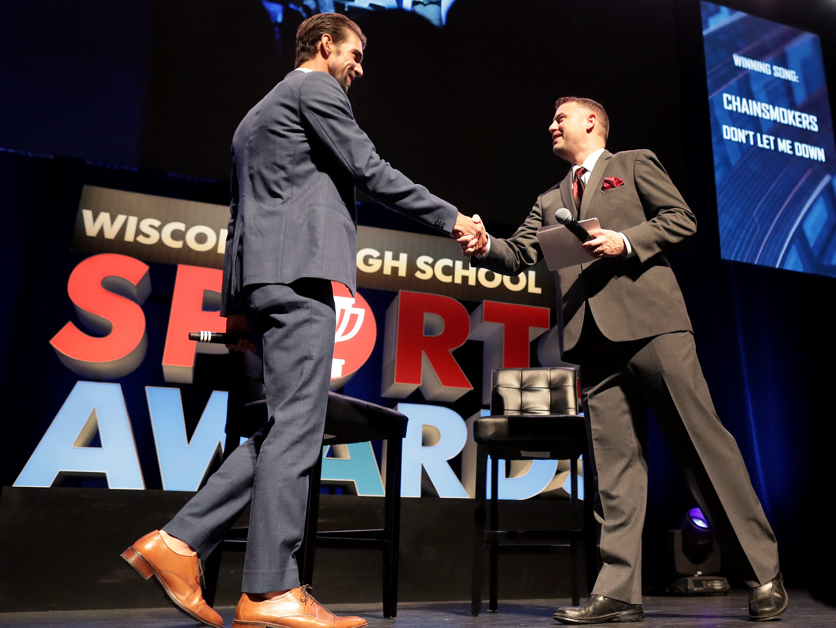 Olympic champion Michael Phelps talks with, host, Brett Christopherson during the Wisconsin High School Sports Awards show at the Fox Cities Performing Arts Center on Wednesday, May 8, 2019, in Appleton, Wis. The annual event was presented by USA TODAY NETWORK-Wisconsin.  Wm. Glasheen/USA TODAY NETWORK-Wisconsin.