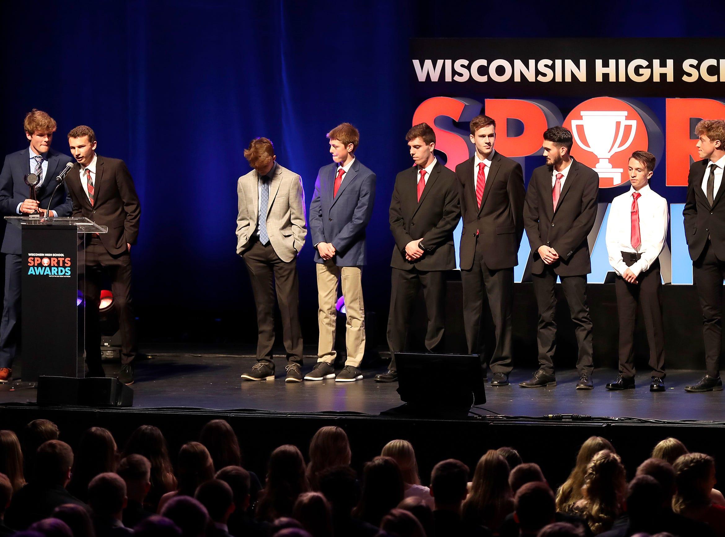 Top Team Fan Vote, the Neenah boys cross country team during the Wisconsin High School Sports Awards show at the Fox Cities Performing Arts Center on Wednesday, May 8, 2019, in Appleton, Wis. Olympic champion Michael Phelps was the guest speaker. The annual event was presented by USA TODAY NETWORK-Wisconsin.  Wm. Glasheen/USA TODAY NETWORK-Wisconsin.