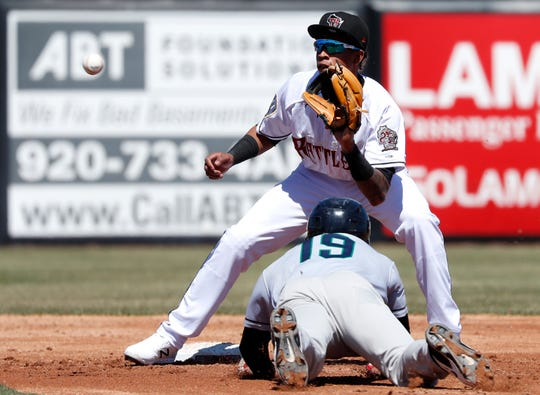 The Timber Rattlers' Yeison Coca waits for the ball at second base before tagging out Gabriel Maciel of the Cedar Rapids Kernels on April 23 at Neuroscience Group Field at Fox Cites Stadium.