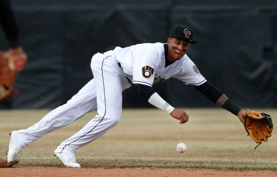Yeison Coca of the Wisconsin Timber Rattlers makes a diving attempt at a ball against the Cedar Rapids Kernels during a game last month at Neuroscience Group Field at Fox Cites Stadium in Grand Chute.