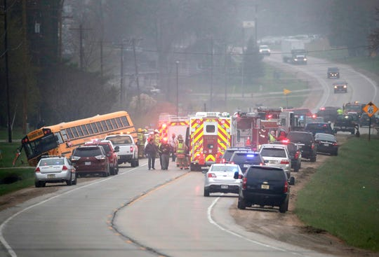 The scene of a three-vehicle crash on Highway 15 involving a Hortonville Area School bus that was empty except for the driver, a four-door car and a pickup truck Thursday, May 9, 2019, in Hortonville, Wis. A passenger of the car, a 10-year-old child, was pronounced dead at the scene. The driver of the car sustained life-threatening injuries and the driver of the bus sustained non life-threatening injuries.