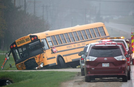 A 10-year-old child died Thursday morning in a three-vehicle crash on State 15 involving a school bus, a car and a pickup truck. Danny Damiani/USA TODAY NETWORK-Wisconsin.