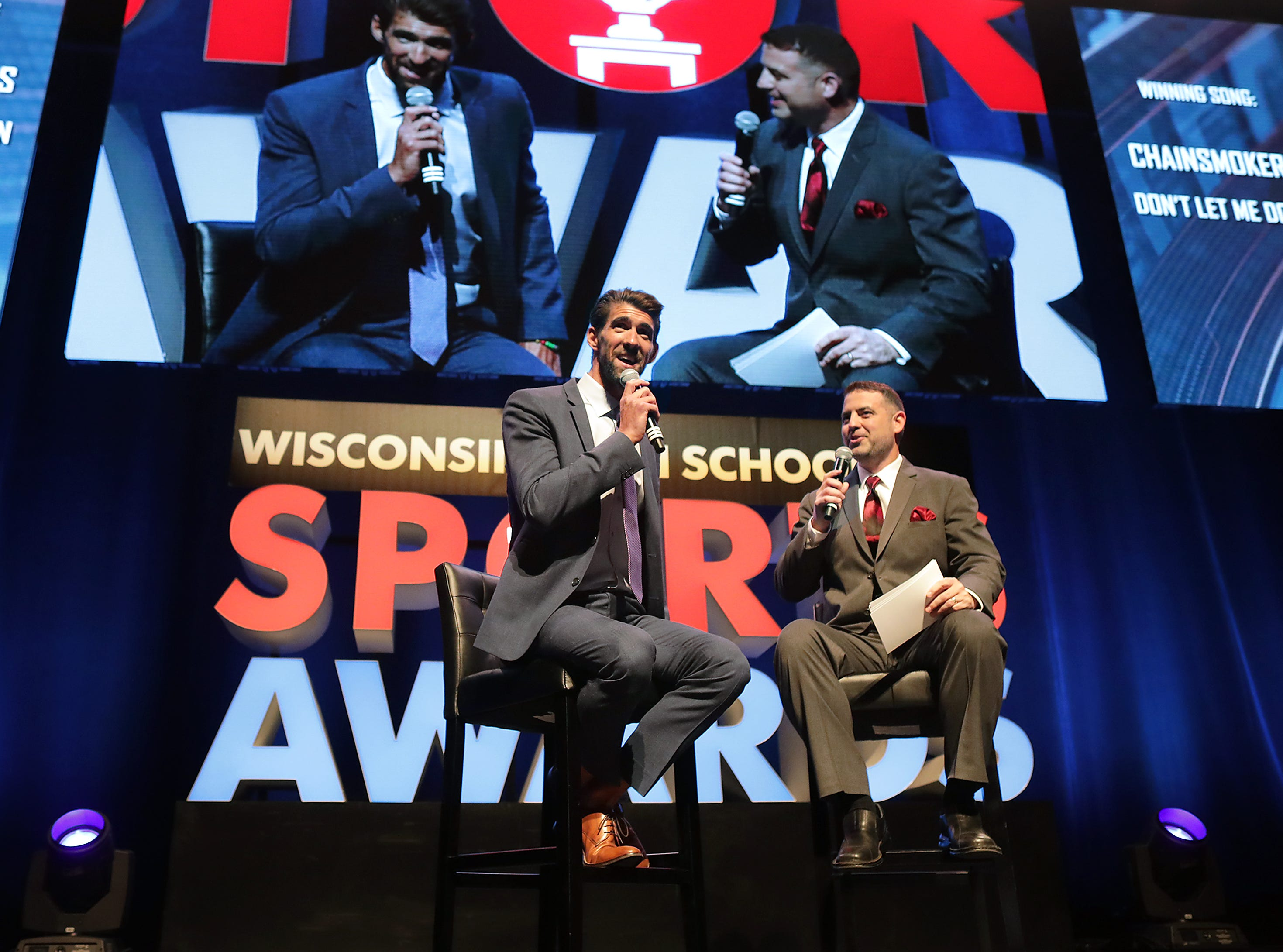 Olympic champion Michael Phelps talks with host Brett Christopherson during the Wisconsin High School Sports Awards show at the Fox Cities Performing Arts Center on Wednesday, May 8, 2019, in Appleton, Wis. The annual event was presented by USA TODAY NETWORK-Wisconsin.  Wm. Glasheen/USA TODAY NETWORK-Wisconsin.