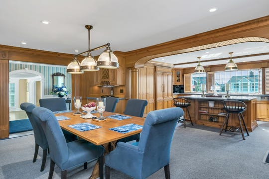 The dining room features plenty of upgrades with recessed lighting and custom built-ins.