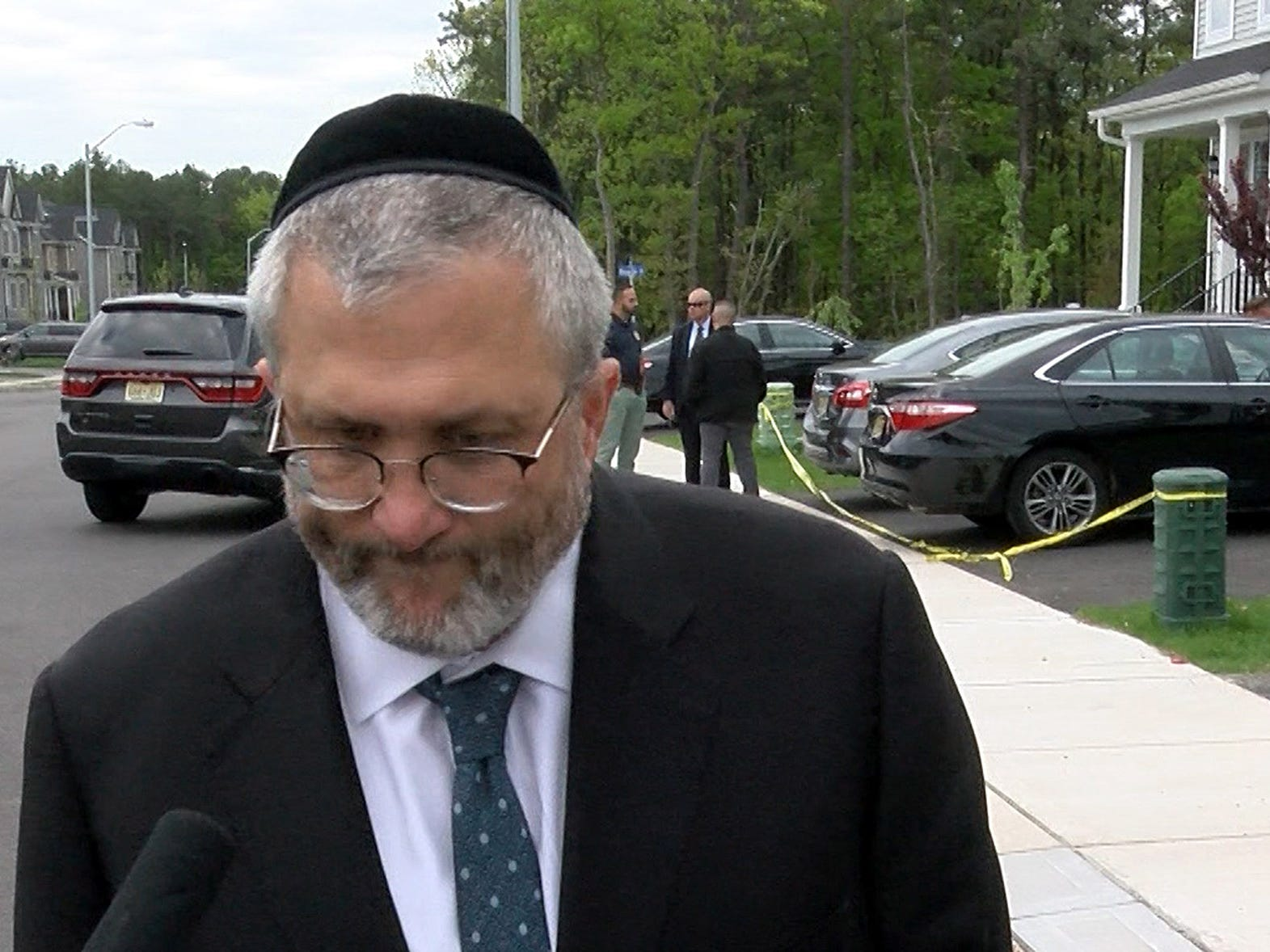 Lakewood Township Committeeman Meir Lichtenstein speaks Monday afternoon, May 6, 2019, outside the home at 18 Lewin Avenue in the township where a child was found unresponsive in a car  and later died at the hospital.