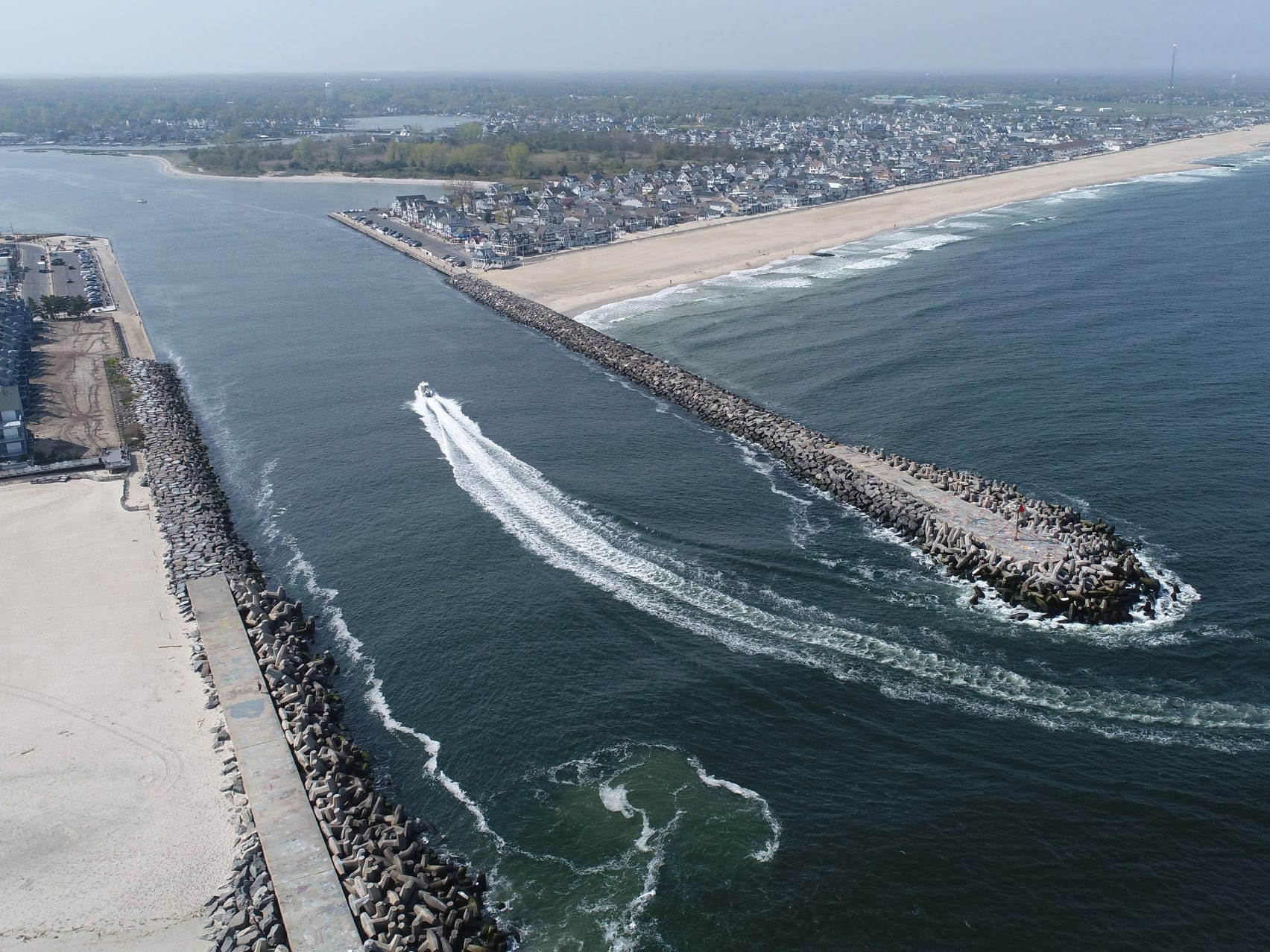 A aerial view from above Point Pleasant Beach, looking north to Manasquan, as a boat heads into the Manasquan Inlet Thursday afternoon, May 2, 2019.