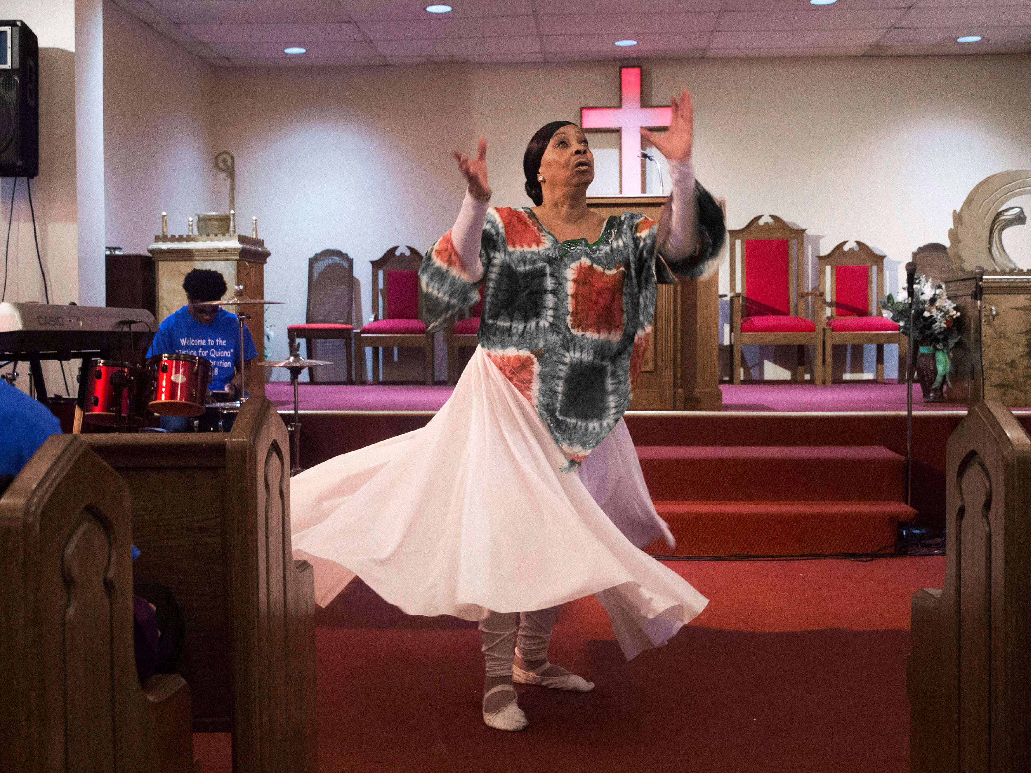 Cindy Dow performs a Praise Dance at the start of service. Every year Penny Dees held a march asking for justice for her daughter who was murdered in 1992. With the murderer found, and charged but still not convicted, Penny decided to hold a victory celebration instead. With the rain, she held the event at her church, the Asbury Park Deliverence Center.