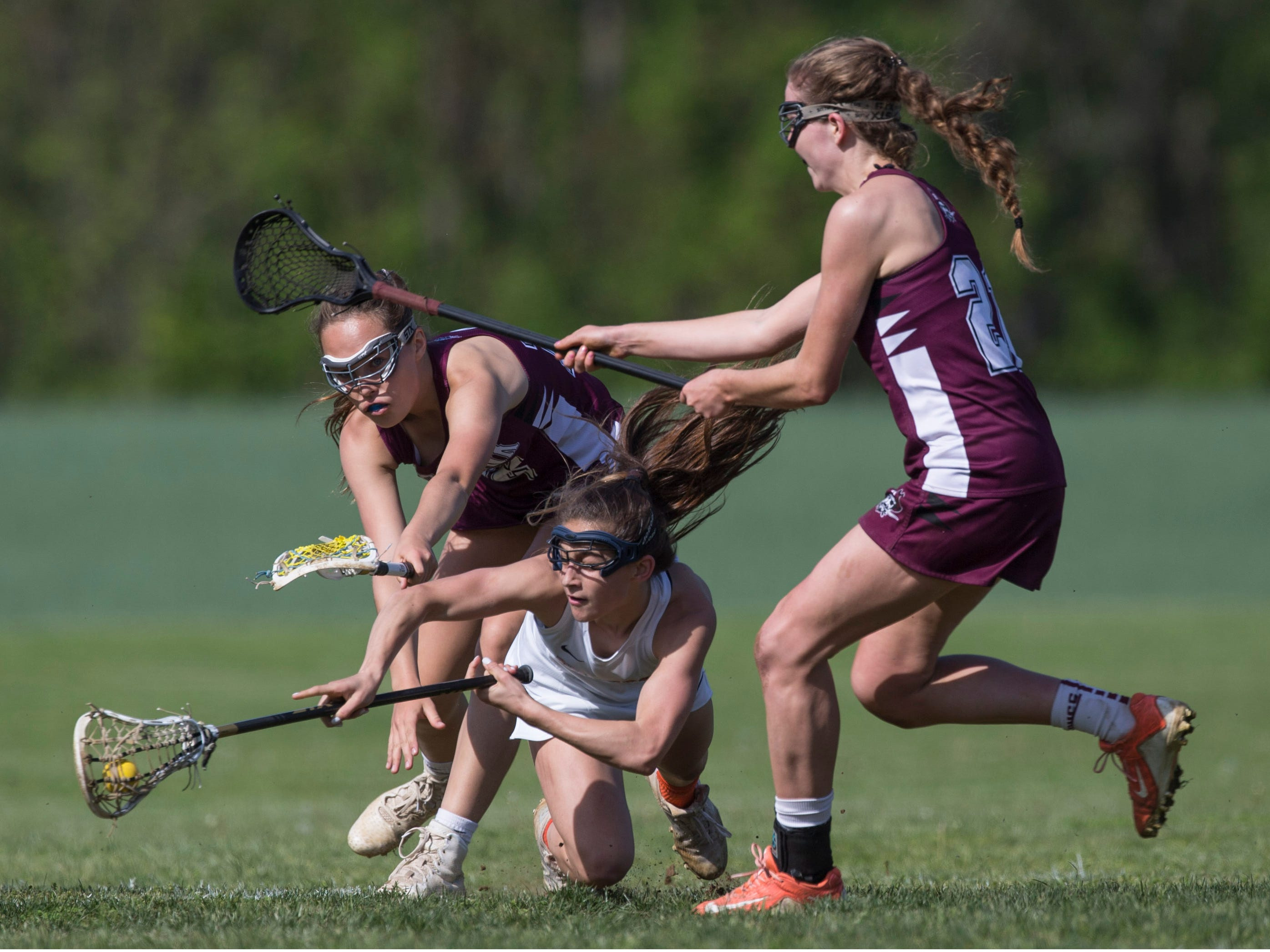 Trinity Hall's Dora Haven is knocked to the ground. Trinity Hall vs Red Bank Regional lacrosse. Colts Neck, NJTuesday, May 7, 2019