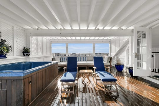 The wet bar and outside rooftop deck.