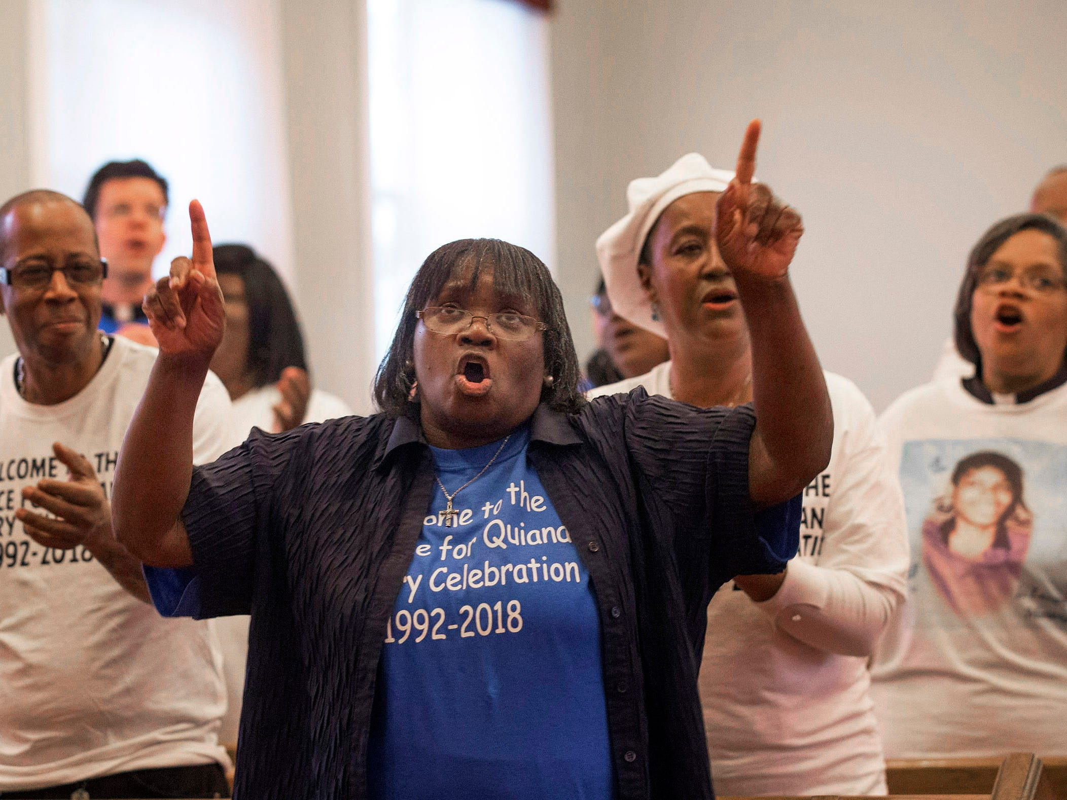 Church member sing during celebration service. Every year Penny Dees held a march asking for justice for her daughter who was murdered in 1992. With the murderer found, and charged but still not convicted, Penny decided to hold a victory celebration instead. With the rain, she held the event at her church, the Asbury Park Deliverence Center.