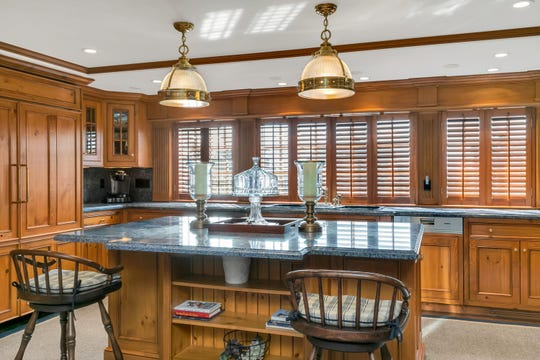 The amazing kitchen features  Blue Bahia Stone countertops and an extended large center island.