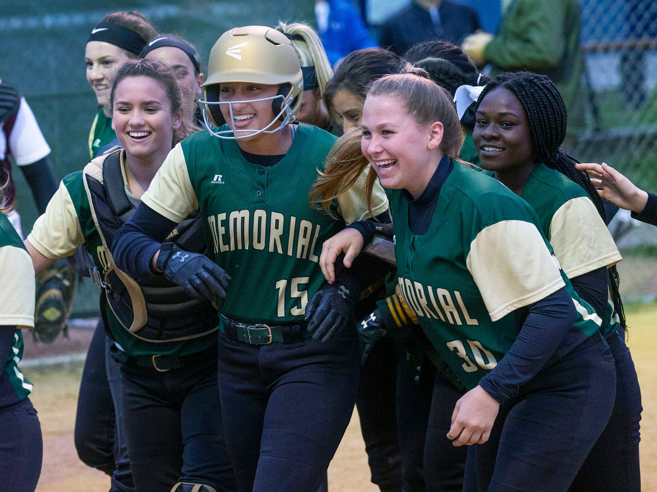 Brick's Kiara Richards is mobbed by team mates after she hit her first of two home runs. Brick Memorial softball defeats Toms River South 9-1 in Ocean County Championship game in Toms River on May 4, 2019.