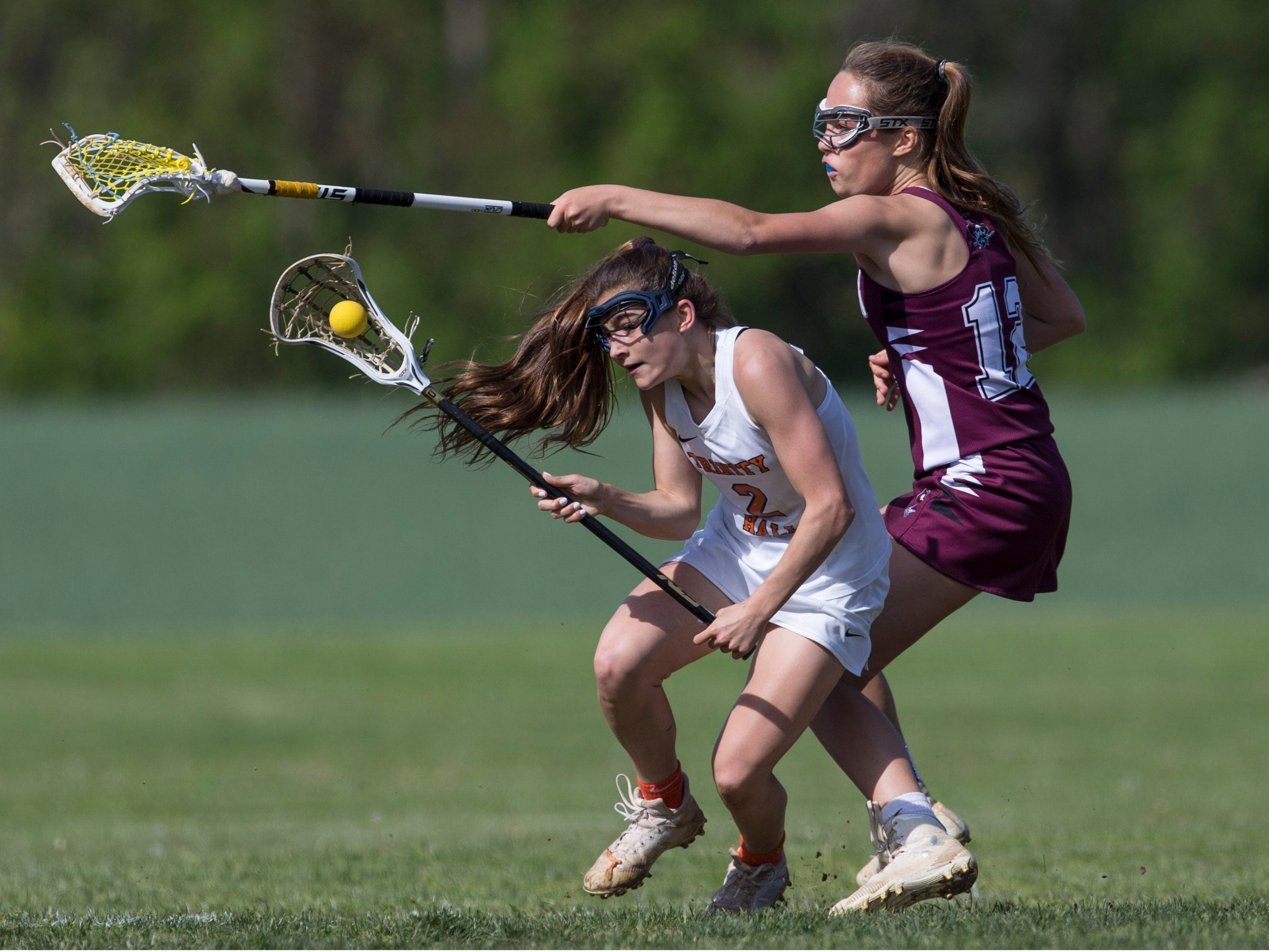 Trinity Hall's Dora Haven gets through the defense of Red Bank Regional's N. Hawthorn. Trinity Hall vs Red Bank Regional lacrosse. Colts Neck, NJTuesday, May 7, 2019