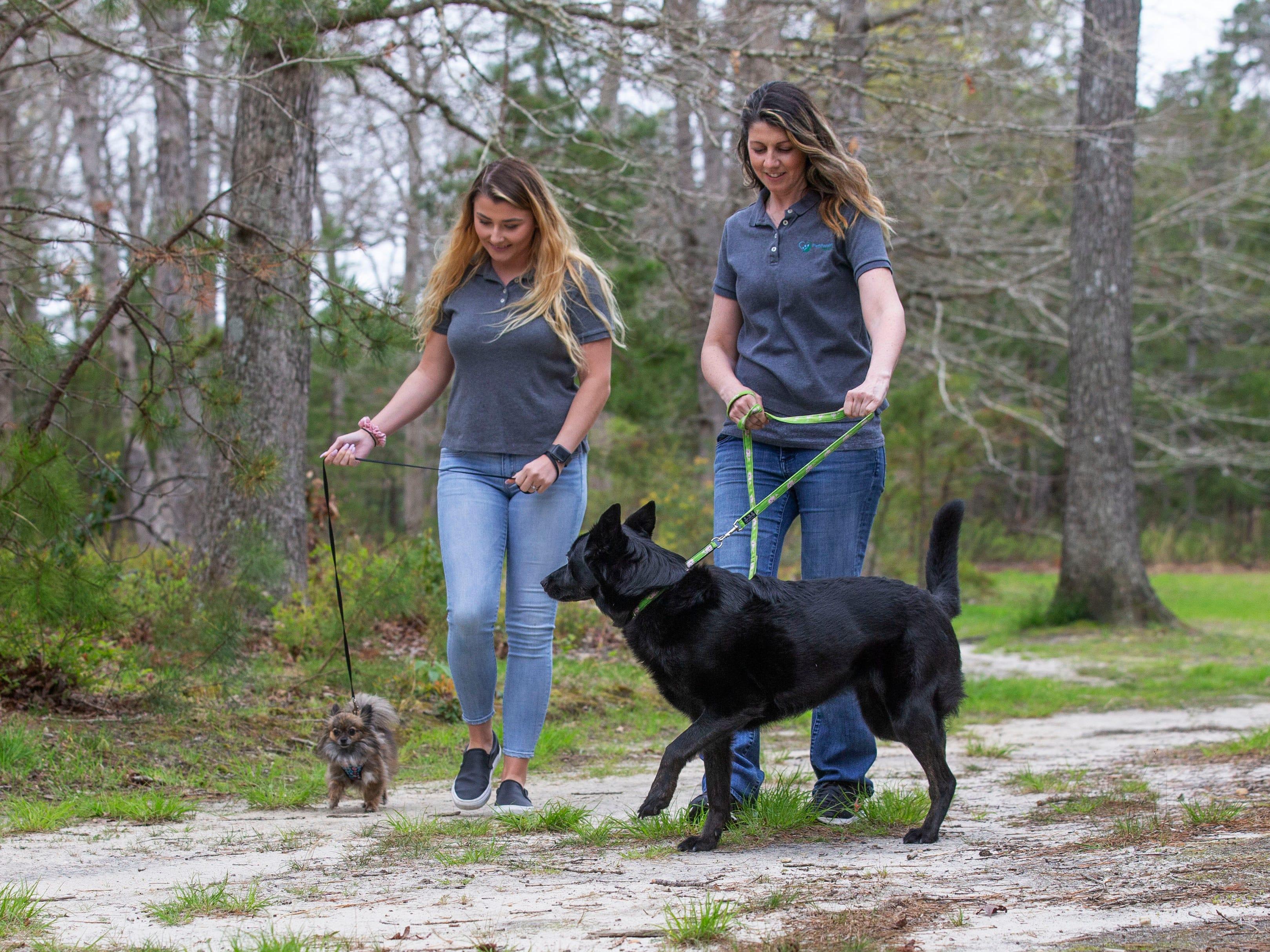 Rose Burke (right) of PetPanion Pet Care in Barnegat walks Zoey while Alexa Merker walks Charlotte.