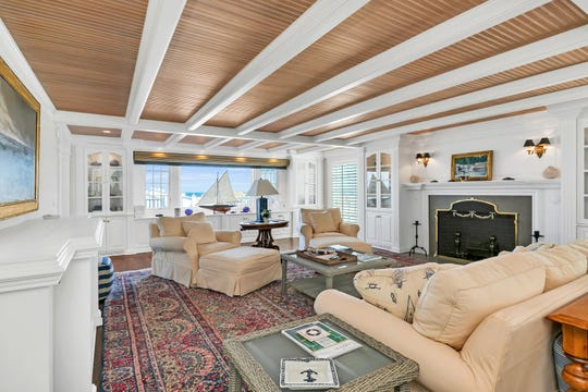 The home offers wonderfully crafted beamed ceilings with custom built-ins.