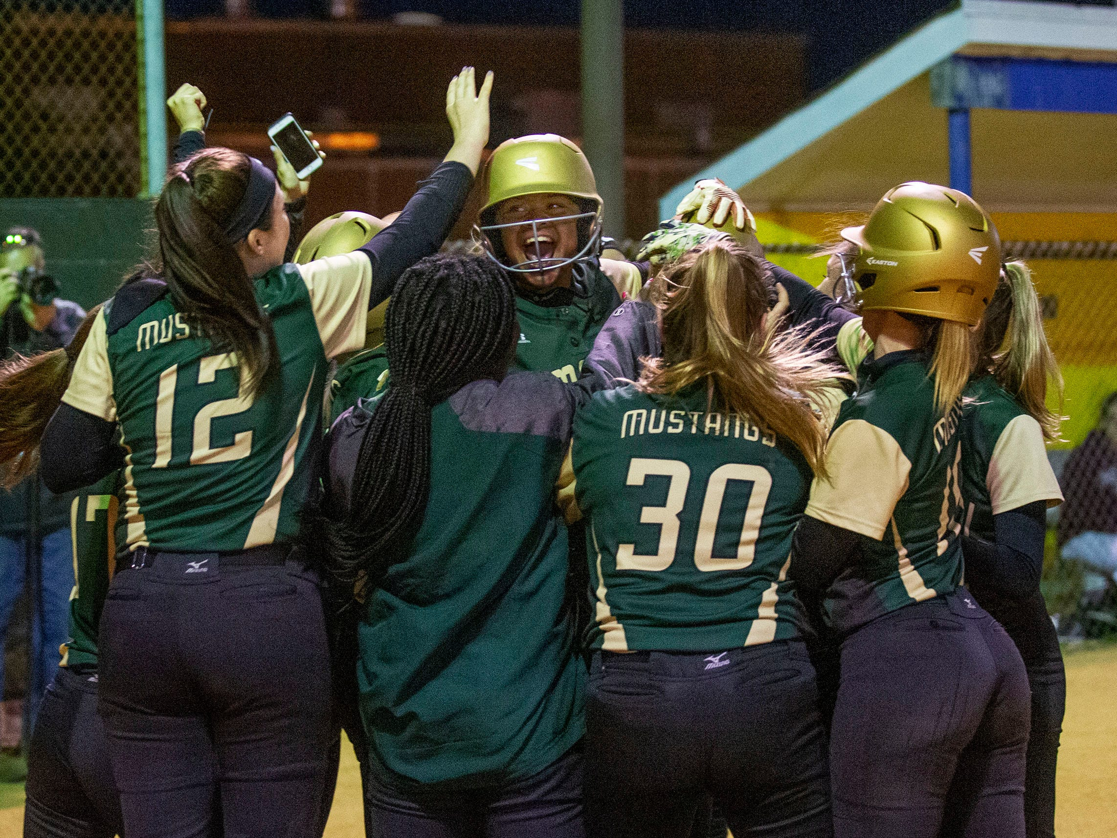 Brick Memorial celebrate as Samanatha Toro and Kiara Richards cross the plate on Richards' second home run of game. Brick Memorial softball defeats Toms River South 9-1 in Ocean County Championship game in Toms River on May 4, 2019.