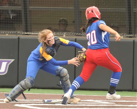 Lipan catcher Erin Green, left, tags out Gorman's Briana Landa on Caitlyn Clark's comebacker to the pitcher in the third inning. The Lady Panthers won the Region II-1A semifinal playoff game 29-0 over Lipan in five innings Thursday, May 9, 2019, at ACU's Wells Field. It was a one-game playoff.