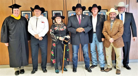 Abilene City Council members and City Manager Robert Hanna, right, dressed the part Thursday to celebrate Western Heritage Classic and — in the case of Councilman Shane Price — college graduations. Every year, the confluence of Mother's Day, Western Heritage and college graduations brings hundreds to town, filling hotels and restaurants. From left: Price (wearing his own cap and gown earned when he graduated from Abilene Christian University), Jack Rentz, Donna Albus, Mayor Anthony Williams, Weldon Hurt, Kyle McAlister and Hanna.