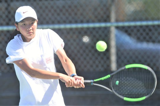 Abilene High sophomore Ruth Hill returns a shot during practice May 8 at the AHS tennis courts. Hill will compete in girls singles at the Class 6A state tournament Thursday in College Station.