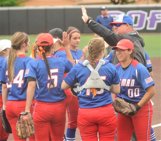 Gorman coach Nick Guthery, right, celebrates with his team after the Lady Panthers' 29-0 victory over Lipan in a Region II-1A one-game semifinal playoff game Thursday, May 9, 2019, at ACU's Wells Field.